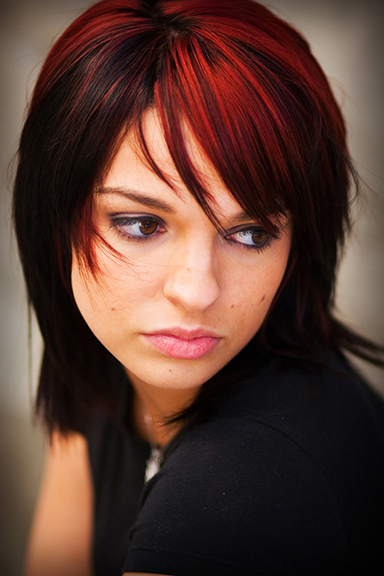 young woman with dark red hair